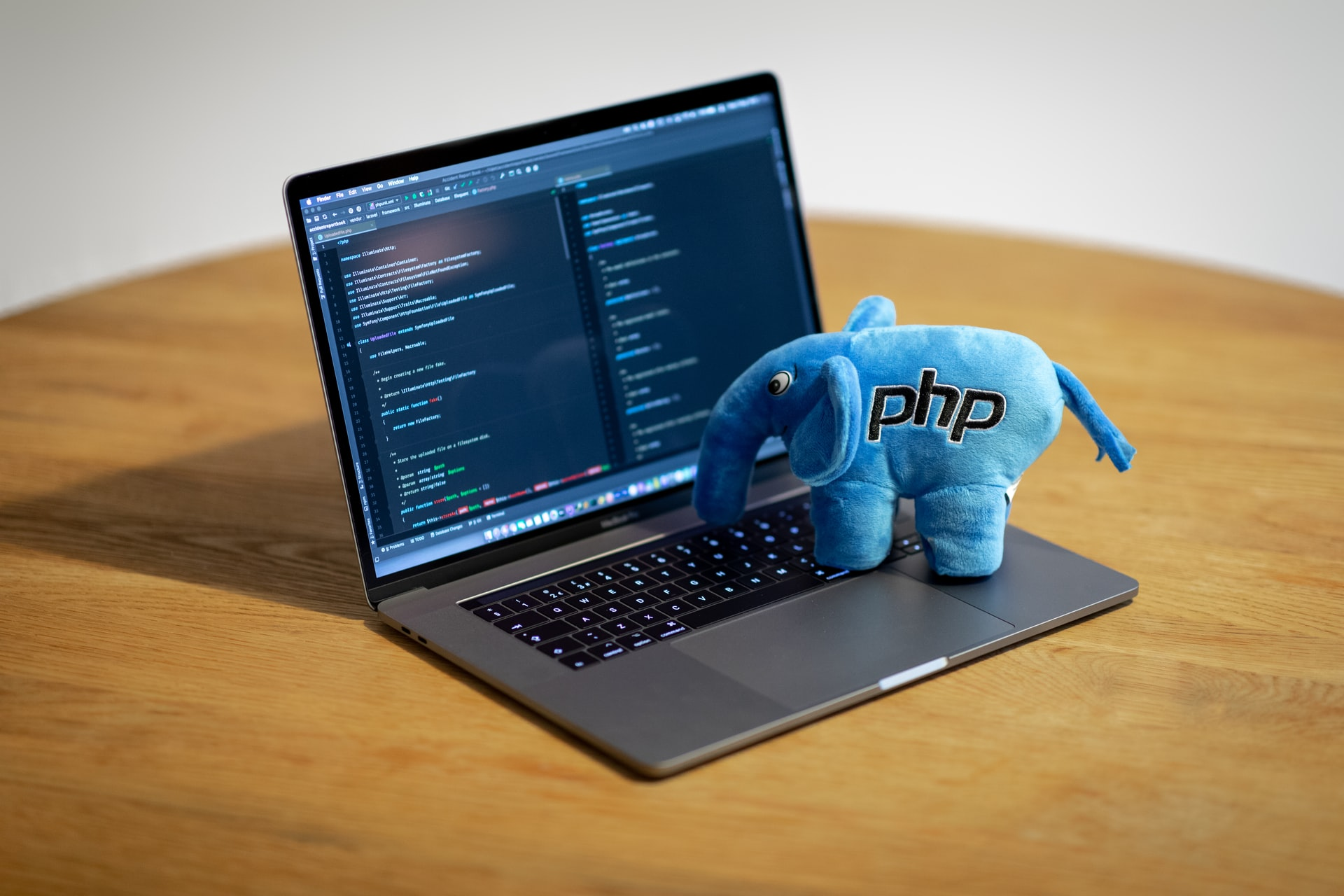 PHP elephant pretending to type on computer